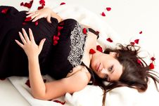 Free Pregnant Woman Lying In Rose Petals Stock Photo - 21742460