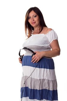 Free Pregnant Woman Holding Headphones At Her Belly Stock Photo - 21742470