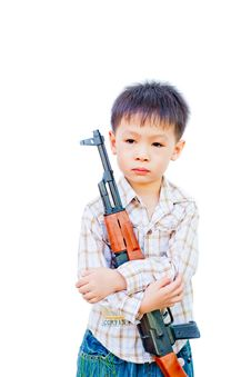 Asian Boy With Gun Stock Image