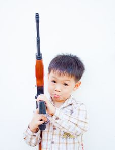 Asian Boy With Gun Royalty Free Stock Photography