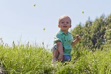 Free Portrait Of A Boy In The Sky And Grass Royalty Free Stock Image - 21743926