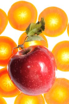 Free Red Apple On Carrot Background Stock Photos - 21756163