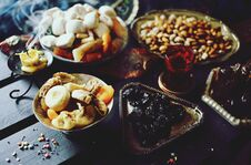 Free Eastern Sweets. Dried Fruits. Nuts. Haze From An Extinguished Candle. Stock Images - 217525944