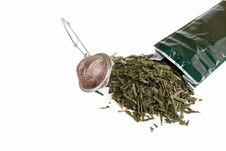Leaves Of Green Tea With Strainer Stock Photography