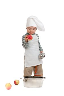 Kitchen Boy With Apples And Pan On White Stock Photos