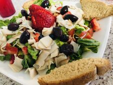 Free Gourmet Style Salad, With Kalameta Olives, Fruit, And More Stock Photography - 217694662