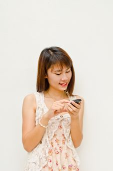 Free Happy Asian Girl Touching Cell Phone Stock Photos - 21774713