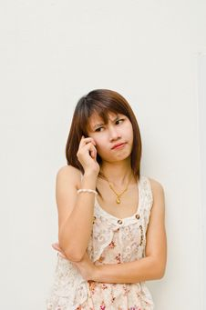 Free Moody Asain Girl Calling To Someone Royalty Free Stock Photo - 21774765