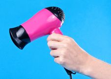 Free Pink Hair Dryer In The Female Hand Royalty Free Stock Photo - 21787485