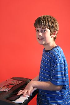 Free Boy On Keyboard Right Vertical Stock Image - 2180561