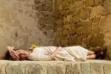 Free Beautiful Young Brunette Girl Lie Down On Wall Royalty Free Stock Image - 21803996