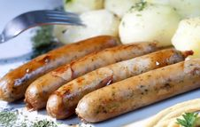 Grilled Sausages With Potatoes Stock Images
