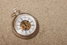 Old Pocket Watch Buried In Sand. Royalty Free Stock Image