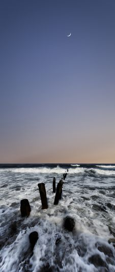 Moonrise Over Surf Stock Image