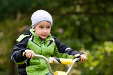 Free Little Boy Riding Bike Outdoors Stock Images - 21810914