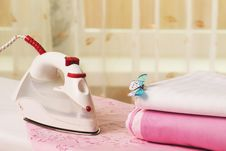 Free Pile Of Colorful Clothes And Electric Iron Stock Images - 21819394