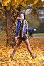 Free Woman At Autumn Walking On Yellow Leafs Royalty Free Stock Images - 21821769