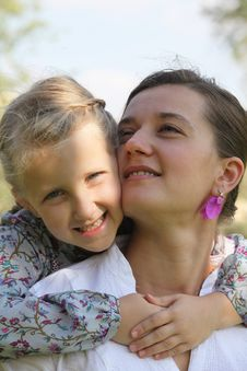 Daughter Hugging Her Mother Stock Images