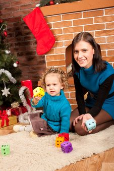 Free Mother And Her Daughter Near Christmas Tree Royalty Free Stock Image - 21838136