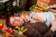 Free Little Girl Play With Dad  Near Christmas Tree Royalty Free Stock Photos - 21839038