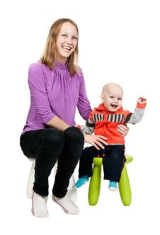 Mother And Son In A Chair In The Studio Royalty Free Stock Images