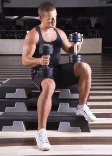 Setting Up His Weights Stock Photography