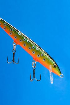 Free Fishing Bait (Wobbler) On Blue Background Royalty Free Stock Image - 21883806