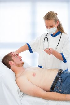Free Young Doctor Checking Patients Temperature - Fever Royalty Free Stock Photo - 21888665