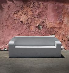 Free Stone Sofa Cracked Plaster Wall Royalty Free Stock Image - 21890346