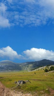 Free Dinara Mountain Over Blue Sky Royalty Free Stock Images - 2195339
