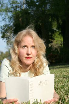Woman Reading Holy Bible In Gr Stock Photos
