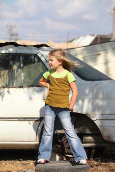 Free Girl Posing Next To A Broken Machine Royalty Free Stock Image - 21911306