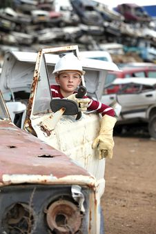 Free Boy At The Dump Cars Stock Images - 21911404