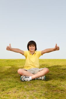 Free Boy Sitting On The Grass Stock Photography - 21927072