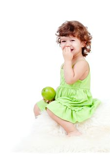 Adorable Little Girl Eating Green Apple Royalty Free Stock Photos
