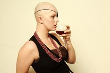 Free Bald Girl With Eye Patch Drinking Wine Stock Images - 21945304