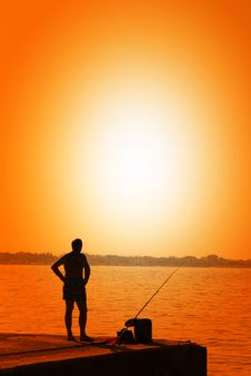 Free Man Fishing On The Pier Royalty Free Stock Images - 21947809