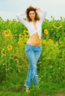 The Beautiful Girl In Sunflowers Stock Image