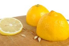 Free Cut Lemon With Seeds On Wooden Cutting Board Stock Photography - 21959742