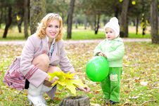 Small Beautiful Girl In Green Suit With Mother Royalty Free Stock Photos