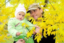 Free Small Beautiful Girl In Green Suit With Father Stock Photo - 21984630