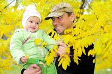 Free Small Beautiful Girl In Green Suit With Father Royalty Free Stock Photography - 21984647