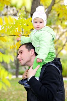 Free Small Beautiful Girl In Green Suit With Father Stock Images - 21984674