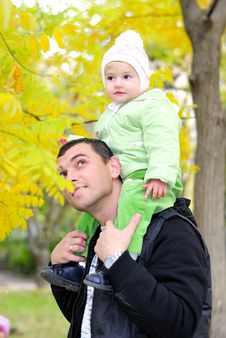 Free Small Beautiful Girl In Green Suit With Father Stock Images - 21984684