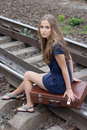 Free Woman Sitting On Rails Stock Images - 21996154