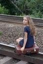 Free Woman Sitting On Rails Stock Photo - 21996380