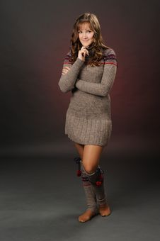 Shot Of A Girl Posing In A Woolen Dress Stock Images