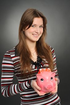 Free Woman With A Piggybank Stock Image - 21991771