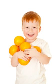 Red-haired Boy With Oranges Isolated On White