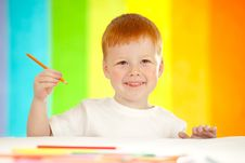 Free Red-haired Adorable Boy On Rainbow Background Stock Image - 21993141